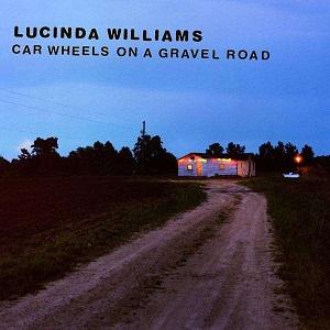 Foto von Car Wheels On A Gravel Road